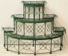 Iron tiered plant stand . . . this would be great on a porch, or sunroom . . . .