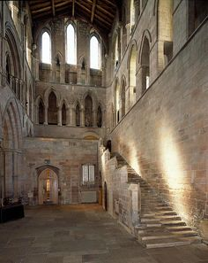 Hexham Abbey: On his right, a flight of steps rose into the wall ... But above his head, a row of lancets ran along the south wall of the nave, supporting the upper part of the wall, and with their feet firmly planted on a ledge a full yard wide.
