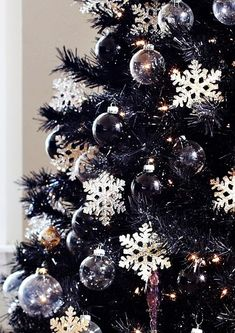 I absolutely love decorating with black Christmas ornaments.  These are super trendy, modern and cool.