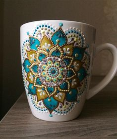 Russian artist Anastasia Safonov makes decorative tableware that's hand-painted with mesmerizing mandala art. Her ceramic plates, mugs, and magnets are painted, dot-by-dot, using acrylic paint in a wide range of vivid colors and finishes. Mandala Art, Mandala Painting, Mandala Design, Dot Art Painting, Pottery Painting, Ceramic Painting, Ceramic Art, Painted Mugs, Painted Rocks