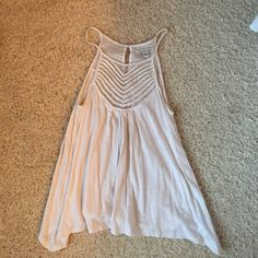 Ivory American Eagle tank top Size small, ivory American eagle float tank. Has some cute detailing at the top! In good shape! American Eagle Outfitters Tops Tank Tops