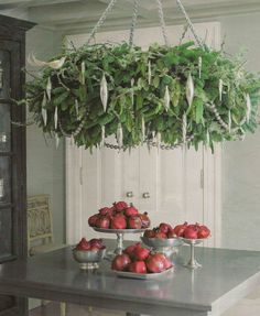 Lush winter foliages with hanging icicles and looped strands of hanging crystals will be incorporated into the chandelier above the kitchen island.