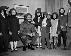Fidel Castro has his beard touched during a visit to his hotel by youngsters who attended a Queens school with his son. The boy was secretly living here while his father led the Cuban revolution. The kids are (l. to r.): Gene Wolf, Kathy Johnston, Kathy Tableman, David Friedlander, Karen Leland and Robert Boyle on April 24, 1959.