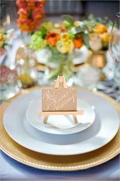 Mini escort card easels holding calligraphy cards. Laura Lavender Calligraphy & Illustration.