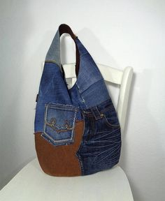 Handmade denim slouchy sack hobo bag. Casual, Rock, Grunge, Western style, Bohemian fashion. Grab and go! Different shades of blue and brown denim. Raw edge patchwork. Cotton dark brown lining. Two pockets on outer. Open pocket inside. Magnetic closure. Machine washable. Made of