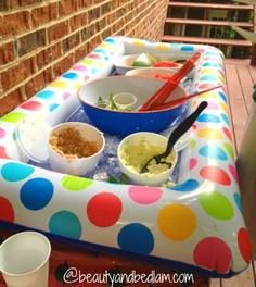 Here is an idea to keep that picnic food cool during a party - blow up pool raft, fill with ice.  Such a practical and simple idea.