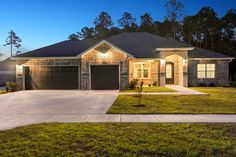 is highlighted by the addition of Another by Elliott Homes. Coastal Living, Home Builders, Home Buying, Luxury Homes, Home And Family, New Homes, Exterior, Mansions, House Styles