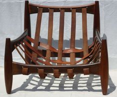 Sergio Rodrigues Midcentury Rosewood Sheriff Chair, Brazil, circa 1962 | From a unique collection of antique and modern lounge chairs at http://www.1stdibs.com/furniture/seating/lounge-chairs/
