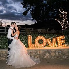 Love :two_hearts:! Our favorite word is embodied in this @watterswtoo bride! :camera::@jennajanellerose | Gown: Nori Skirt and Maelin Corset.