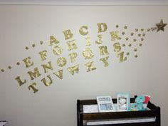 DIY shooting star created by glittered alphabet along with glittered foam stars. Perfect in adding a lil sparkle to your nursery.