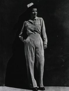 An Army Nurse dressed in the brown-and-white striped seersucker slacks and matching shirt as newly authorized during 1943. This uniform was issued to army nurses serving in overseas medical facilities or aboard hospital trains, planes or ships ~
