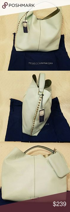 Rebecca Minkoff large hobo NWT Minkoff hobo with side studs and matching pouch. Dust bag included. 18 inches wide and 15 inches high. Selling on ebay for 250. Rebecca Minkoff Bags Hobos