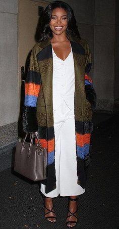 Gabrielle Union wears a striped Suno overcoat