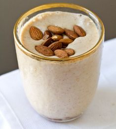 Easy Energy Almond Shake  vegan, serves 2  2 cups almond milk or soymilk, vanilla flavor  2 large frozen bananas, ripe  2 Tbsp almond butter  1/2 cup ice  1/4 tsp cinnamon  garnish: roasted almonds  Directions:  1. Place all ingredients in a high power blender. Blend on high until smooth and thick.  2. Pour into glasses and garnish with roasted almonds.