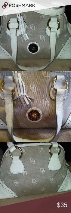 Cleaning sale!!DOONEY BOURKE White leather and denim handbag nice must go too many bags packed down needs to home and just a lil tlc. Nice bag! Dooney & Bourke Bags Mini Bags