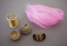 DIY Felt Acorns~ You'll need:     wool roving     acorn caps     thread     drill     hot glue gun     dishwashing soap     2 bowls