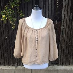 Button Down Chiffon Peasant Blouse Slightly hi-low. Creamy beige color. Loose, flowy, charming bronze buttons. So beautiful with a long necklace (one pictured is sold separately). Slightly sheer. Sized small, but It's loose fitting so would fit a M/L as well. Bottom of sleeves are elastic. Poetry Tops Tunics