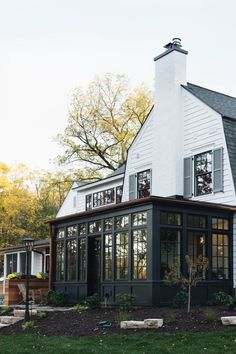 Jean Stoffer Design sunroom addition Get an inside look into Syd and Shea McGee's home process. How founders of interior design company Studio McGee found and implemented inspiration for their timeless and transitional home exterior. Colonial House Exteriors, Dutch Colonial Homes, White Exterior Houses, Dutch Colonial Exterior, Colonial House Remodel, Home Exteriors, Exterior Homes, White Houses, Studio Mcgee