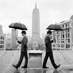 NYC. Duel with umbrellas in Midtown // by Rodney Smith