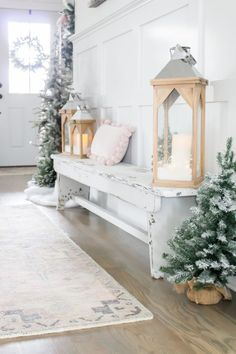 Love this modern Farmhouse Christmas entryway décor. Love the bench and the big lanterns with candles int hem. The bench is so cute. The Christmas trees on each side of the bench are perfect. Christmas Entryway, Farmhouse Christmas Decor, Christmas Home, Farmhouse Decor, Modern Farmhouse, Farmhouse Style, Farmhouse Design, White Christmas, Christmas Trees
