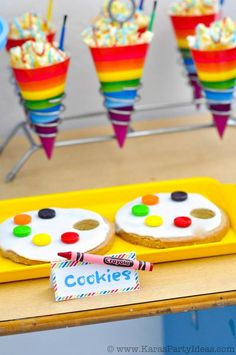 Love these paint pallet cookies! Art Colorful Rainbow Themed birthday party via KarasPartyIdeas.com