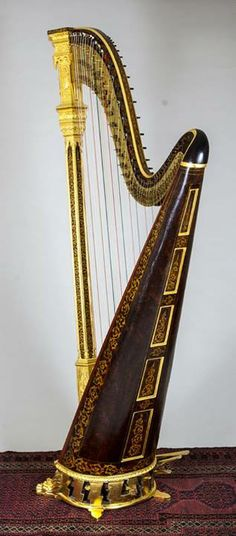8 - pedal harp with swell doors closed.