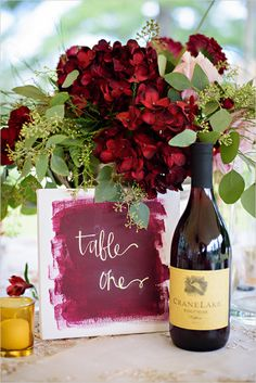 painted table number in red and gold... matches the red wine!