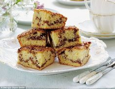 Pecan and Cinnamon Ripple Squares ~ butter cake with cinnamon-sugar swirls & crunchy pecans, like a pecan Danish in a sponge ~ recipe from the book 'Mary Berry's Absolute Favourites' | via Daily Mail