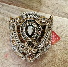 There's nothing like a cuff to add dimension and class to an outfit....as seen on display Calanit, Sotogrande  #doricsengeri #statementcuff #statementbracelet #couturejewelry #designerjewelry #goldtrend