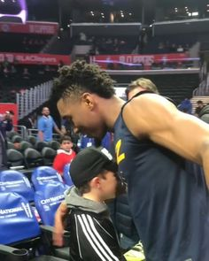 e9c7e6346 Donovan Mitchell ( spidadmitchell) gives his shoes away to a young fan a the