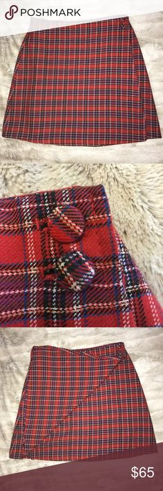 VINTAGE 90s Plaid High Waist Wrap Mini Skirt  VINTAGE 90s Clueless style Plaid wrap mini skirt! Red yellow green and purple/blue plaid with two plaid fabric buttons and one internal black button for wrap skirt closure. Fits at the waist to wear with a cropped top or to cinch the waist with a tucked in top. Excellent condition from a smoke & pet free home! ✌️ 13.5 in. Waist, 16.5 in long Vintage Skirts Mini