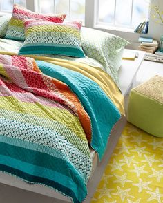 "Hand-pieced from vibrant horizontal bands of retro-inspired prints and bright solids, our lightweight hand-quilted bedding takes the ""patchwork"" quilt to the next level."