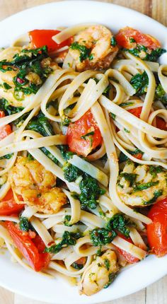 Looking for a light, healthy, Mediterranean-style seafood pasta? Try this Shrimp Tomato Spinach Pasta in Garlic Butter Sauce. Fettuccine pasta smothered in juices from fresh vegetables, garlic, and shrimp. Fish Recipes, Seafood Recipes, Pasta Recipes, Dinner Recipes, Cooking Recipes, Healthy Recipes, Dinner Ideas, Diabetic Recipes, Delicious Recipes