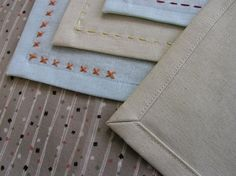 hand-embroidered napkins with instructions for making beautiful mitered corners