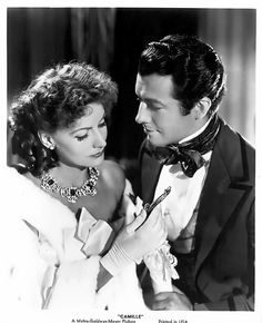 Greta Garbo & Robert Taylor in Camille (La Dame aux Camelias) 1936, George Cukor, MGM, Costumes by Adrian and wearing Joseff Hollywood Jewelry