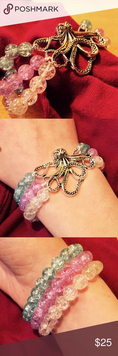 Real silver octopus bracelet Beautiful silver plated octopus surrounded by 3 strands of crackle beads. Clear, purple, and blue. Stretches to fit any wrist. An absolute must have. Jewelry Bracelets