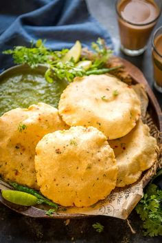 Aloo Puri is a delicious Indian bread which is made by mixing boiled potatoes with flour and spices. This Punjabi deep fried poori is great to serve for breakfast or snacks. Here is how to make Aloo Puri Recipe. Puri Recipes, Gujarati Recipes, Veg Recipes, Potato Recipes, Snack Recipes, Indian Appetizers, Indian Snacks, Appetizer Recipes, Indian Bread Recipes