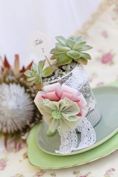 succulent wedding table number idea -- we could put table numbers in the gold potted succulent vase if you'd like.