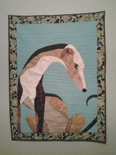 Check out this item in my Etsy shop https://www.etsy.com/listing/205934004/oak-greyhound-quilt-wall-hanging