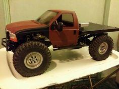 My Trailfinder 2. 2-speed, Holmes hobbies Crawlmaster 20t motor and  BR-XL esc, KMS 180oz K4 winch in back,  custom bed , Tamiya 350 cab, Ya... that's it.