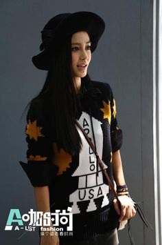 Angelababy at Qi Chong Fashion Week wearing famous Apollo Rocket sweater from Stuart Verver's debut Coach NY RTW F/W 2014 collection in September 2014