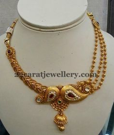Jewellery Designs: Jhumka Attached Antique Set