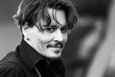 Johnny Depp Photos Photos - Image has been converted to black and white.) Actor Johnny Depp attends the premiere of Disney's 'Pirates Of The Caribbean: Dead Men Tell No Tales' at Dolby Theatre on May 18, 2017 in Hollywood, California. - Premiere of Disney's 'Pirates of the Caribbean: Dead Men Tell No Tales' - Red Carpet