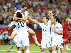 United States forward Kelley O'Hara, top, celebrates her goal during the second half against Germany in the semifinals of the Women's World Cup in Montreal. The U.S. won 2-0.  Jean-Yves Ahern, USA TODAY Sports
