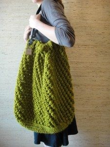 This giant knit tote My Purls of Wisdom made with Wool-Ease Thick and Quick is big enough to hold everything you need for the day.
