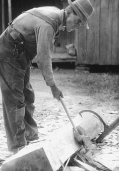 """Modern carpenters would not know what """"cracking"""" a log was, for instance; and yet, the pioneer artisans of old had to make their boards by that method. It consisted in driving the blade of an ax or hatchet into the small end of a log by means of a maul, and inserting wooden wedges, called """"gluts."""" On either side of this first central """"crack"""" another crack was made, and gluts placed therein. #appalachia"""