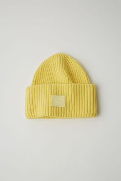 d302134963b Acne Studios Pansy N Face pale yellow is a ribbed lambswool beanie hat.  Pale Yellow