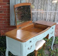 This looks exactly like the one I just bought, just a lot dirtier and stinkier  French Provincial Vanity Desk Painted Soft Aqua by HarrisMarksHome