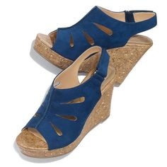 """The first-ever Cushion Walk® fashion wedge turns these 3 3/4"""" H heels into comfort footwear. Hook-and-loop closure. Faux-suede upper. Features three teardrop cut-outs on each side with an open toe and slingback heel. The ankle strap has a hook & loop closure. Half sizes, order one size down. · Upper: Faux-suede · Sole: Faux-cork · Heel: 3 3/4"""" H · Cleaning: Wipe with a dry cloth · Imported"""