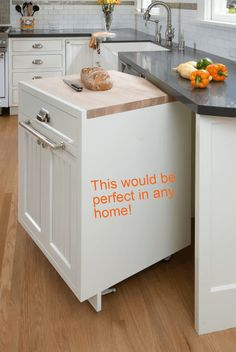 a rolling cart fits under the kitchen counter to maximize space